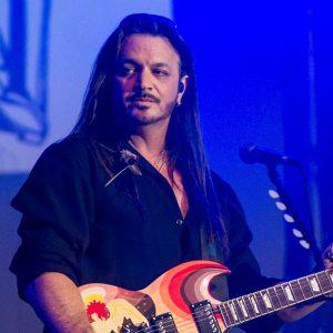 Guitarist in live concert decades rewind
